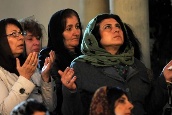 women cover head in church